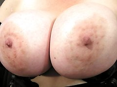 Big titted mama playing with her pussy