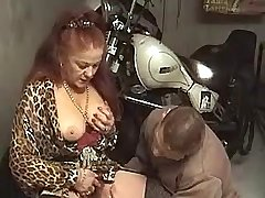 Young biker fucks old whore in ass with finger