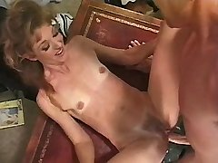 Mature w little tits sucks dick and fucks on table