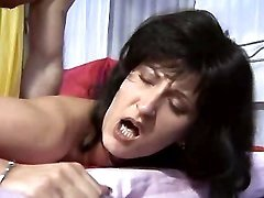 Spicy brunette milf getting banged