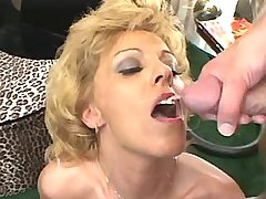 Blonde milf in stockings gets facial after hot sex