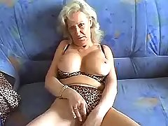 Old fart plays with her big shabby cunt on couch