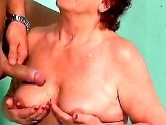 Naughty granny gets breast jizzed