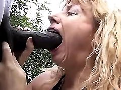 Mature sucks big black cock outdoor