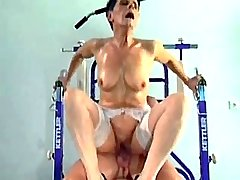 Granny in white stockings takes dick ride in gym
