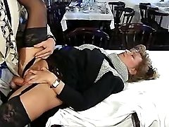 Lusty mature satisfys boss on table