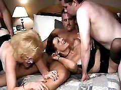 Three men fuck old ladies in orgy